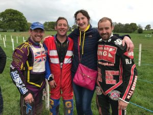 Mary Lomas from Thorneycroft Solicitors with motorcycle riders at Gawsworth Cheshire Grasstrack Club